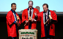 Prince William takes part in a Sake Barrell Breaking Ceremony with Japanese Astronaut Soichi Noguchi (left) and Andy Palmer (CEO of Aston Martin) at an 'Innovation is Great' Event at Roppongi Hills
