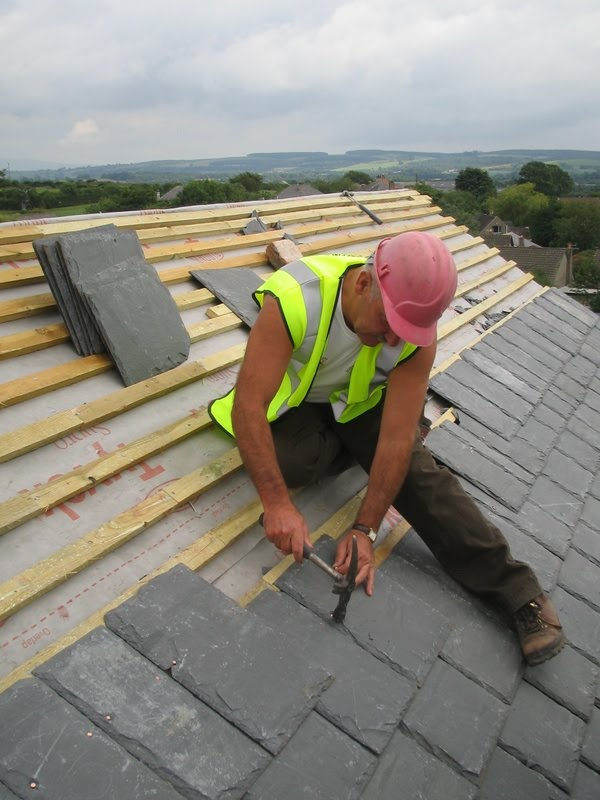 Roofing contractor doing a roof repair