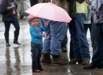 Zelda Thompson, 2, of Pasadena waits in the rain to entry NRG Stadium for RodeoHouston at the Houston Livestock Show and Rodeo in Monday, March 9, 2015, in Houston.