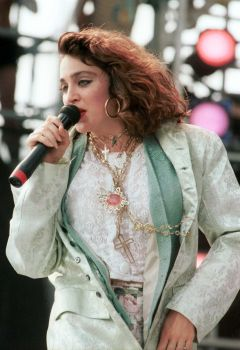 Madonna ditches the blond hair for the first time since gaining fame. Here she performs at the Live Aid concert at JFK Stadium in Philadelphia, Pennsylvania, July 13, 1985. Photo: Frank Micelotta, Getty Images / Getty Images North America
