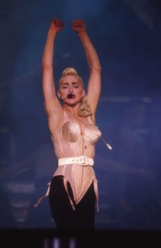 French designer Jean Paul Gaultier designed the costumes for the Blond Ambition tour, including this pink satin cone bustier. Photo: Frank Micelotta, Getty Images / Getty Images North America