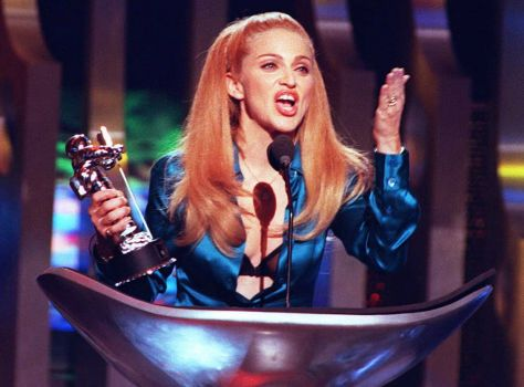 "With ""I Dream of Jeannie"" hair and her bra exposed, Madonna blows the crowd a kiss after receiving the award for Best Female Video during the 1995 MTV Video Music Awards held at Radio City Music Hall in New York. Photo: DON EMMERT, AFP/Getty Images / AFP"