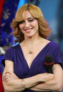 Madonna rediscovers the '70s as she appears onstage during MTV's Total Request Live at the MTV Times Square Studios on October 17, 2005 in New York City. Photo: Evan Agostini, Getty Images / 2005 Getty Images