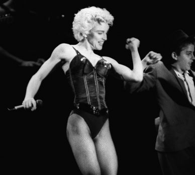 "Madonna completely transformed her look for her ""True Blue"" album, with short blond hair and a sculpted body. Here she performs August 28, 1987 during a concert held in the park of the town of Sceaux, located in the southern suburb of Paris. Photo: BERTRAND GUAY, AFP/Getty Images / AFP"