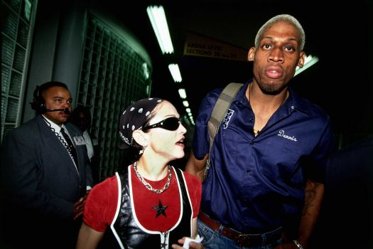 Madonna sports a basketball jersey as she leaves the Los Angeles Sports Arena with then-boyfriend Dennis Rodman. Photo: Andrew D. Bernstein, NBAE/Getty Images / 1994 NBAE