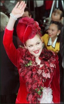 "Madonna waves to her fans as she arrives at the Shrine Auditorium in Los Angeles December 14, 1996 for the premiere of the movie ""Evita,"" in which she played the title role. Photo: TIZIANA SORGE, AFP/Getty Images / AFP"