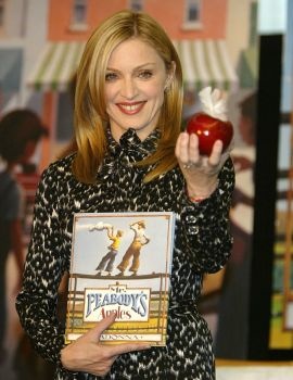 "Madonna poses with her new children's book ""Mr. Peabody's Apples"" at the Borders Bookstore December 9, 2003 in Los Angeles, California. Photo: Carlo Allegri, Getty Images / 2003 Getty Images"