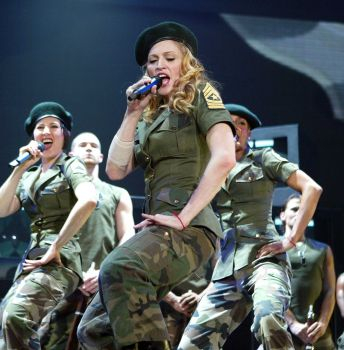"Madonna performs onstage during her ""Re-Invention"" World Tour 2004 at The Great Western Forum, May 26, 2004 in Inglewood, California. The outfit she is wearing is designed by Christian LaCroix. Photo: Frank Micelotta, Getty Images / 2004 Getty Images"