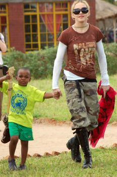 A picture taken on March 30, 2009 shows Madonna with her son, Malawian adoptee, David Banda (L) at the Mphandula Child Care Centre -- built by Madonna's charity, Raising Malawi -- on March 30, 2009 in Lilongwe. Photo: AMOS GUMULIRA, AFP/Getty Images / 2009 AFP