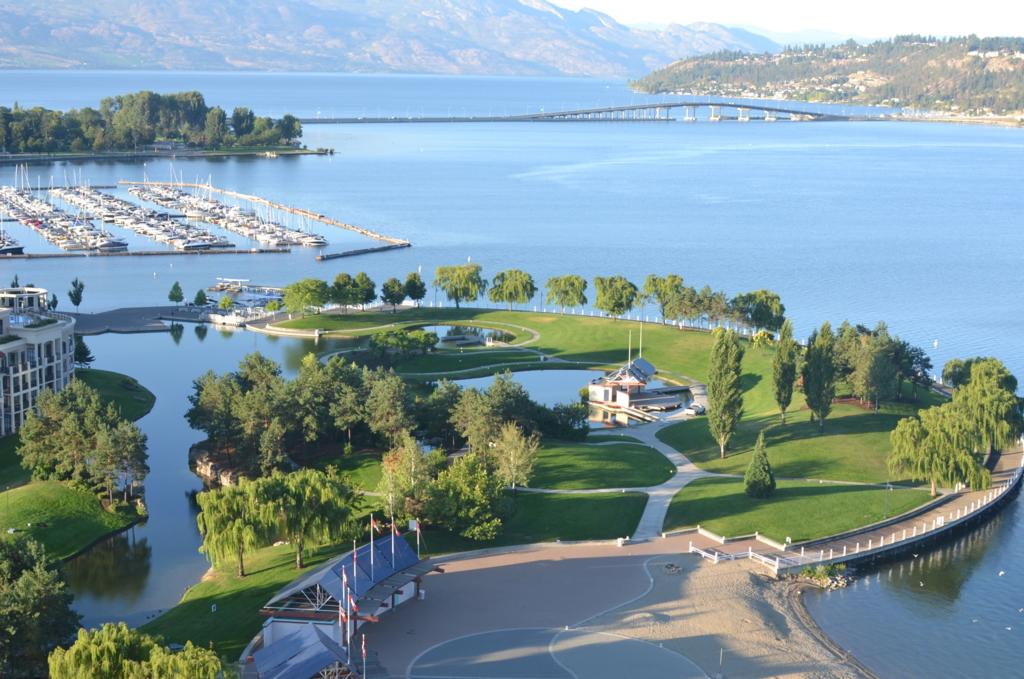 View of Kelowna BC boardwalk, island stage, bridge, yacht club KYC
