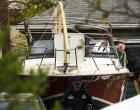 Members of the FBI Evidence Recovery Team inspect the boat where Boston Marathon bombing suspect Dzhokhar Tsarnaev was hiding at 67 Franklin St. in Watertown, Massachusetts, April 20, 2013. With Dzhokhar Tsarnaev, the surviving suspect in the Boston Marathon bombings lying seriously wounded in a hospital and unable to speak on Saturday, investigators worked to determine a motive and whether the ethnic Chechen brothers accused of the attack acted alone. REUTERS/Lucas Jackson (UNITED STATES - Tags: CRIME LAW CIVIL UNREST TPX IMAGES OF THE DAY)