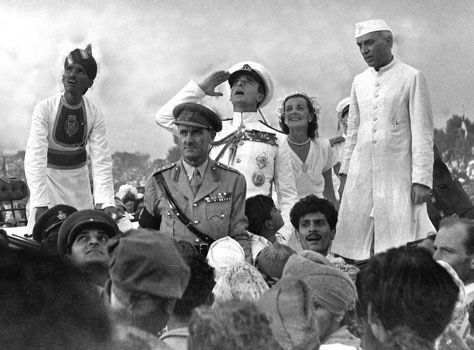 last viceroy of India Lord Mountbatten salutes the Indian National Flag