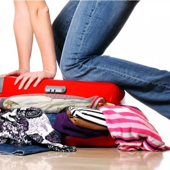 packing-woman-travel-suitcase