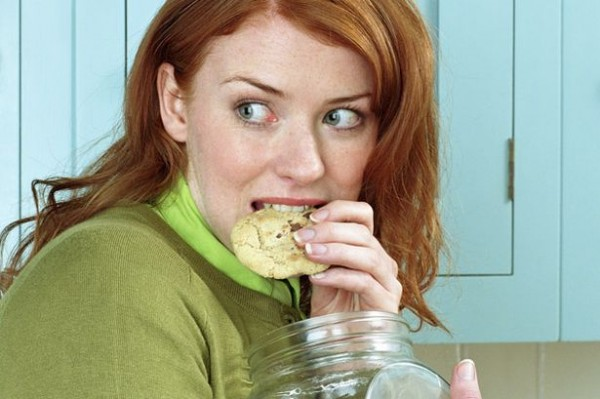 Woman secretly eating cookies-758434