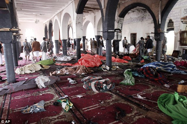 The mosques are mainly used by supporters of the Shi'ite Muslim Houthi group as well as Sunni worshippers. Above, bodies were covered in blankets after the blast