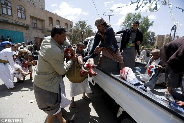 Injured people are carried on to a truck to be taken to hospital. Around 351 people are thought to be injured, medical officials reported