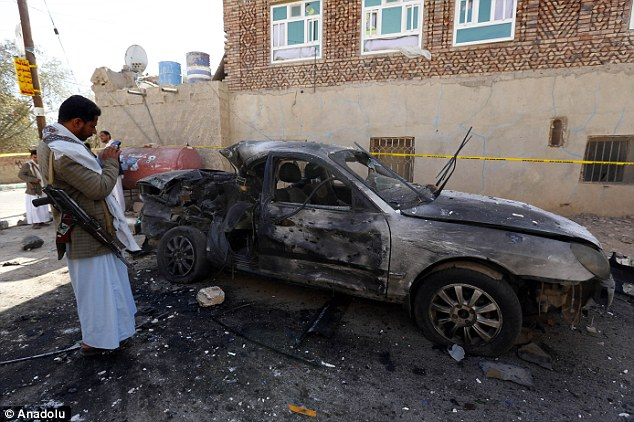 Wreckage: A burned out car could be seen near the scene of one of the blasts outside the Al-Hashoush Mosque
