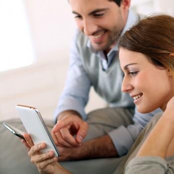 happy-couple-phone-home