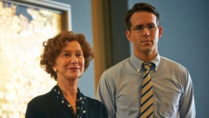 This photo provided by The Weinstein Company shows, Helen Mirren, left, and Ryan Reynolds, in a scene from the film, 'Woman in Gold.'