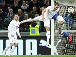 31 March 2015: England forward Harry Kane (C) fights for the ball with Italy defender Giorgio Chiellini at the Juventus Stadium in Turin