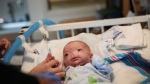 Eli Thompson is treated at the NICU at USA Children's and Women's Hospital in Mobile, Ala., on March 19, 2015. (AP / AL.com / Sharon Steinmann)