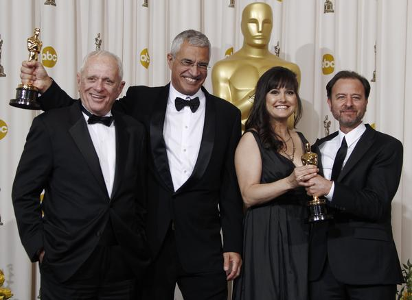 From left, Rick Barry, Louie Psihoyos, Paula DuPre Pesman and Fisher Stevens pose backstage Sunday night with the Oscar for best documentary feature,