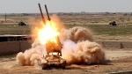 Iraqi security forces launch rockets against Islamic State extremist positions in Tikrit, 130 kilometres north of Baghdad, Iraq, Tuesday, March 31, 2015. (AP / Khalid Mohammed)