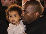 Performer Kanye West, center, carries his child North West as they arrive at a hotel in Yerevan, Armenia, Wednesday, April 8, 2015. American television star Kim Kardashian has arrived in the capital of her ancestral Armenia for a visit expected to draw attention to the centennial of the massacre of 1.5 million Armenians. (AP Photo/Samvel Berkibekyan, PAN Photo)