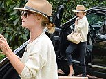 UK CLIENTS MUST CREDIT: AKM-GSI ONLY\nEXCLUSIVE: Rosie Huntington-Whiteley visits a friend on a rainy Tuesday afternoon in Los Angeles, CA on April 7, 2015. The blonde bombshell wore a beige fedora, a light cream sweater, cropped navy blue trousers and finished her ensemble with olive green designer heels.\n\nPictured: Rosie Huntington-Whiteley\nRef: SPL993849  070415   EXCLUSIVE\nPicture by: AKM-GSI / Splash News\n\n