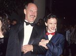 BEVERLY HILLS, CA - JANUARY 18:   Actress Juliette Lewis and father actor Geoffrey Lewis attends the 49th Annual Golden Globe Awards on January 18, 1992 at the Beverly Hilton Hotel in Beverly Hills, California. (Photo by Ron Galella, Ltd./WireImage)