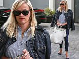 Picture Shows: Reese Witherspoon  April 07, 2015\n \n 'Wild' actress Reese Witherspoon is seen leaving her office in Beverly Hills, California. Reese dressed casually in a print blouse, blue skinny jeans and a black leather jacket over her shoulders.\n \n Non-Exclusive\n UK RIGHTS ONLY\n \n Pictures by : FameFlynet UK © 2015\n Tel : +44 (0)20 3551 5049\n Email : info@fameflynet.uk.com