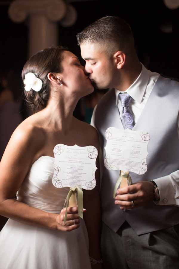 bride and groom, kiss, ceremony program fans, classic purple and gray wedding, Abby Grace Photography