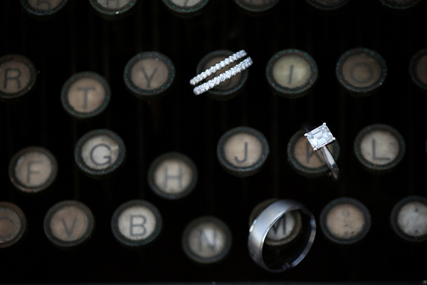 vintage type writer ring shot, wedding rings on vintage typewriter keys, Katelyn James Photography, Jasmine Star Photography