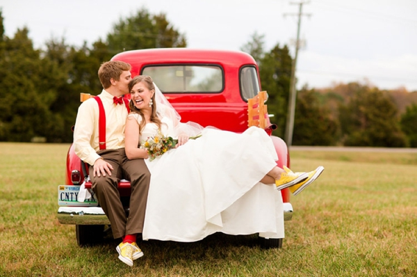 bride and groom in matching yellow Converse sneakers, rustic wedding fashion