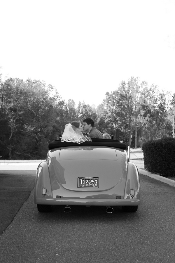 teal vintage Ford convertible getaway car, bride and groom say farewell with a kiss, Katelyn James Photography, Jasmine Star Photography