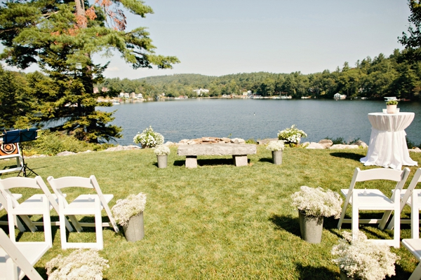 lakeside ceremony, galvanized buckets of baby's breath as aisle decor, simple lakeside wedding, peach, pink, beige, cream, and mint wedding ideas, Ruth Eileen Photography