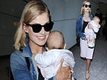 12.APRIL.2015 - LONDON - UK\n*** EXCLUSIVE ALL ROUND PICTURES ***\nACTRESS ROSAMUND PIKE ARRIVES BACK WITH HER BABY SON ATOM INTO LONDON HEATHROW AIRPORT WITH A BIG SMILE ON HER FACE, AFTER A LONG FLIGHT IN FROM LOS ANGELES \nBYLINE MUST READ : XPOSUREPHOTOS.COM\n***UK CLIENTS - PICTURES CONTAINING CHILDREN PLEASE PIXELATE FACE PRIOR TO PUBLICATION ***\n**UK CLIENTS MUST CALL PRIOR TO TV OR ONLINE USAGE PLEASE TELEPHONE  442083442007