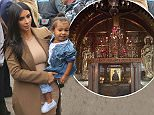 Kim Kardashian holds daughter North in arms as she visits church in Gyumri with family on her trip in Armenia. Kim looks very happy upon walking into the church as Khloe followed behind her. Upon arrival the girls were standing near a building with the Armenian flag just directly above them. They all entered the church with heavy police protection to be able to enjoy their time in the city and landmarks.  Pictured: Kim Kardashian, North West, Khloe Kardashian Ref: SPL996724  110415   Picture by:  Splash News  Splash News and Pictures Los Angeles: 310-821-2666 New York: 212-619-2666 London: 870-934-2666 photodesk@splashnews.com