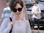 EXCLUSIVE: Lily Collins arrives to body pilates in west hollywood for an early morning work out to maintain her slim body!  Pictured: Lily Collins Ref: SPL995255  130415   EXCLUSIVE Picture by: M A N I K (NYC)/ Splash News  Splash News and Pictures Los Angeles: 310-821-2666 New York: 212-619-2666 London: 870-934-2666 photodesk@splashnews.com