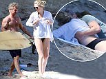 PREMIUM EXCLUSIVE - Sean Penn and girlfriend Charlize Theron took a trip down to Malibu beach for a bit of sun and surfing.  Sean got int the water with his board, while Charlize stayed on beach in her black bikini, on Sunday, April 12, 2015 X17online.com\nNO WEB SITE USAGE.\nNO PAPER USAGE\nNO MAGAZINE USAGE\nAny quieries please call Alasdair or Gary on office 0034 966 713 949/926 or mibile Gary 0034 686 421 720 or Alasdair on 0034 630 576 519