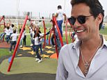 Singer Marc Anthony, in the company of his wife Shannon de Lima, opens her second orphanage for homeless children in Latin America on April 12, 2015 in Barranquilla, Colombia. In this center, 100 children receive health care, education, recreation and counselling.\n\nPictured: Marc Anthony\nRef: SPL921322  120415  \nPicture by: Elkin Cabarcas / Splash News\n\nSplash News and Pictures\nLos Angeles: 310-821-2666\nNew York: 212-619-2666\nLondon: 870-934-2666\nphotodesk@splashnews.com\n
