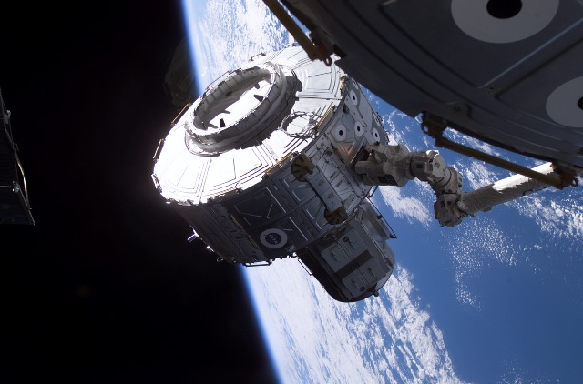 Canadarm2 moving the Quest Airlock into position for installation onto the ISS Unity Node, NASA photo s104e5068.jpg