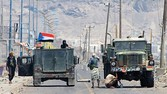 """Supporters of Yemen's Southern Separatist Movement keep position around armed vehicles flying the movement's flag near the International airport in the port city of Aden, as battles against Shiite Huthi rebels continue, on May 3, 2015. The Saudi-led coalition battling rebels in Yemen sent a """"limited"""" force to the city of Aden earlier in the day, according to Yemeni sources, in what would be its first ground deployment inside the country. AFP PHOTO / SALEH AL-OBEIDI"""