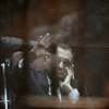 Ousted Egyptian president Hosni Mubarak sits in the defendant's cage during his verdict hearing in a retrial for embezzlement on Saturday in the capital Cairo. The Egyptian court sentenced Mubarak and his two sons to three years in prison.
