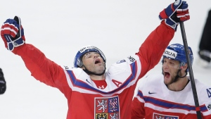 Jaromir Jagr, left, celebrates during the Hockey World Championships quarterfinal in Prague, Czech Republic, on May 14, 2015. (AP / Petr David Josek)