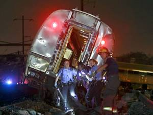Emergency personnel work the scene of a deadly train wreck