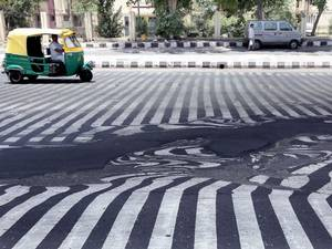 The extreme heat is melting the roads in Delhi