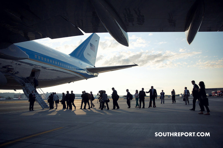 White house staff boarding airforce one in boeing fields, Seattle.