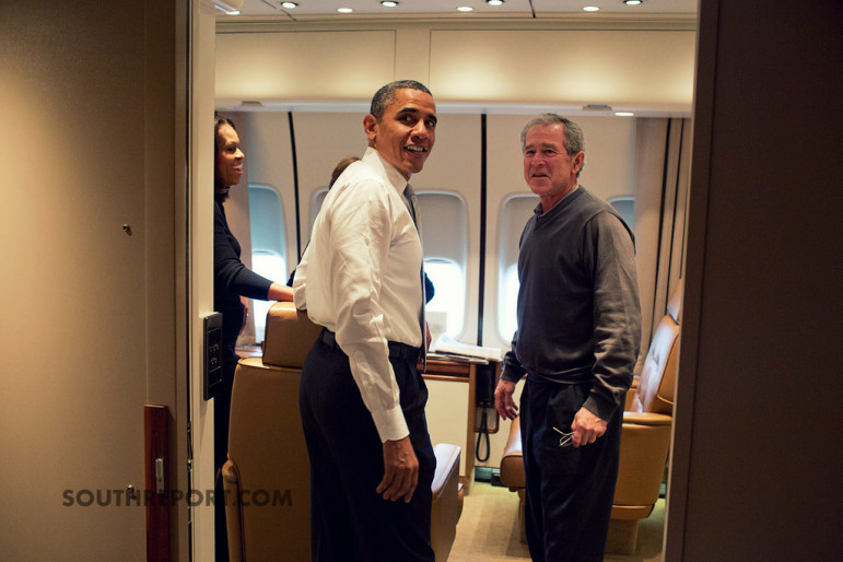 President Obama and former president George Bush aboard Airforce One enroute South Africa.