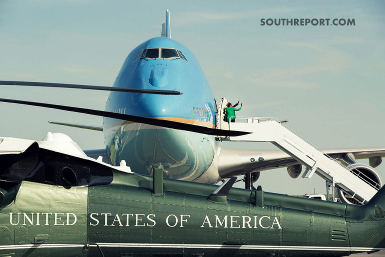 Marine One and Airforce One in a picture with President Obama and the First Lady Boarding.